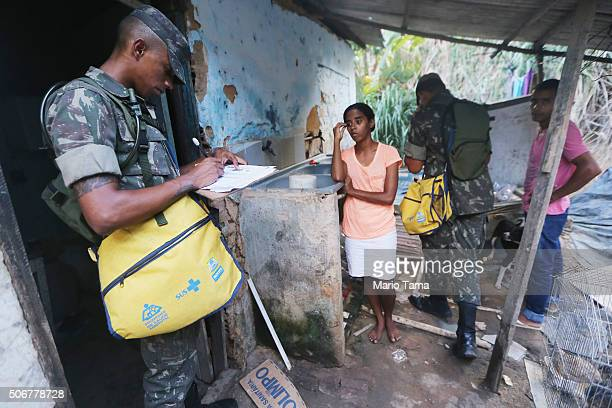 Brazilian Army soldiers inspect a home while canvassing a neighborhood in an attempt to eradicate the larvae of the mosquito which causes the Zika...