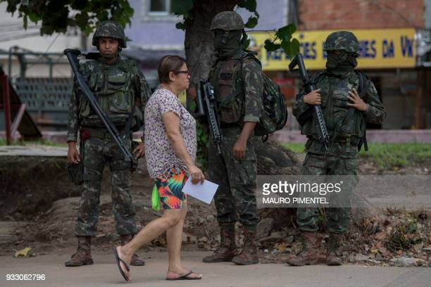 Brazilian Army soldiers patrol during a permanent operation at Vila Kennedy favela in Rio de Janeiro Brazil on March 17 2018 The chaos in the favelas...