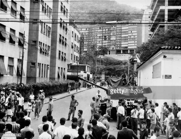 Brazilian army tanks stand in front of Laranjeiras Palace on April 01 1964 in Rio de Janeiro during the military putsch that led to the overthrow of...
