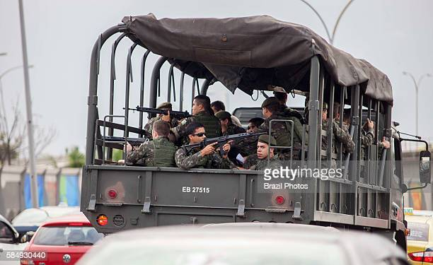 Brazilian Army truck passes by Complexo da Mare a massive network of favelas that sits alongside the Linha Vermelha the main highway from the Rio de...