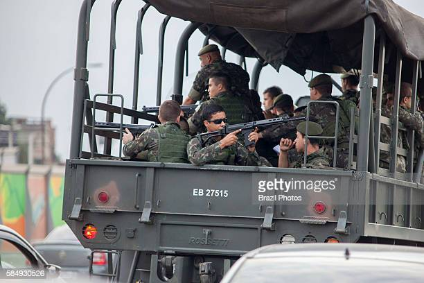 Brazilian Army truck passes by Complexo da Mare, a massive network of favelas that sits alongside the Linha Vermelha , the main highway from the Rio...