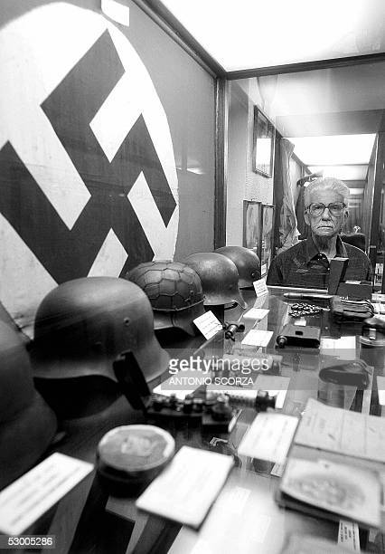 Brazilian army World War II veteran colonel Sergio Gomes Pereira, stands beside a cabinet displaying German memorabila captured by the Brazilians...