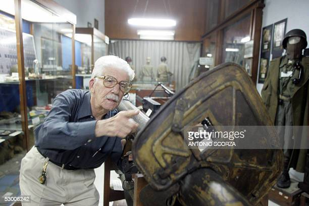 Brazilian army World War II veteran colonel Sergio Gomes Pereira, points at a German Panzershreck anti-tank weapon captured by the Brazilians during...