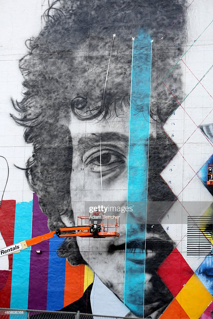 Brazilian artist Eduardo Kobra and his team paint a 60 foot by 150 foot mural of musician Bob Dylan on the side of a building on August 28, 2015 in Minneapolis, Minnesota. Over the next two weeks, Kobra and his team of three Brazilian artists and two from Minnesota, will finish the painting of Dylan, a Minnesota native.