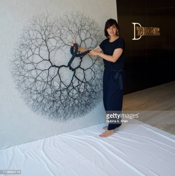 Brazilian artist Janaina Mello Landini installs her 'Ciclotrama' art works made from bespoke linen crafted by D'Decor a $300 million company and the...