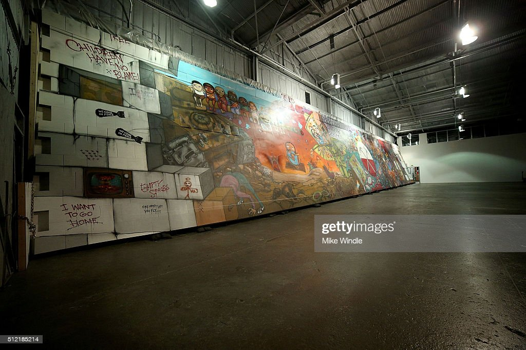 Brazilian artists Osgemeos' interpretation of 'The Wall' is displayed during Roger Waters hosts Los Angeles Event in celebration of the release of the Limited Edition box set of the film 'Roger Waters The Wall' on February 24, 2016 in Los Angeles, California.