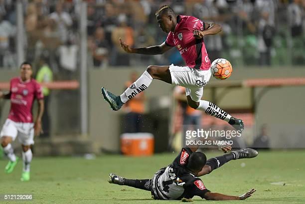Brazilian Atletico Mineiro player Erazo vies for the ball with Ecuadorian Independiente del Valle player Jose Angulo during their 2016 Libertadores...