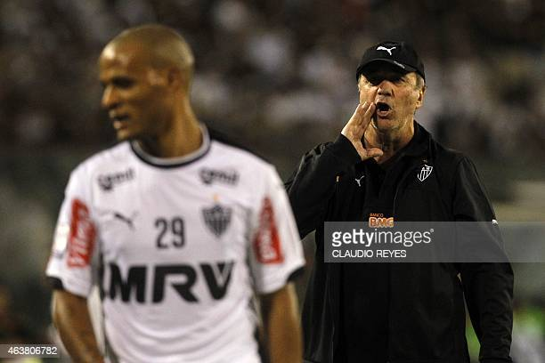 Brazilian Atletico Mineiro's coach Levir Culpi gives instructions to his players during their Copa Libertadores football match against Chile's Colo...