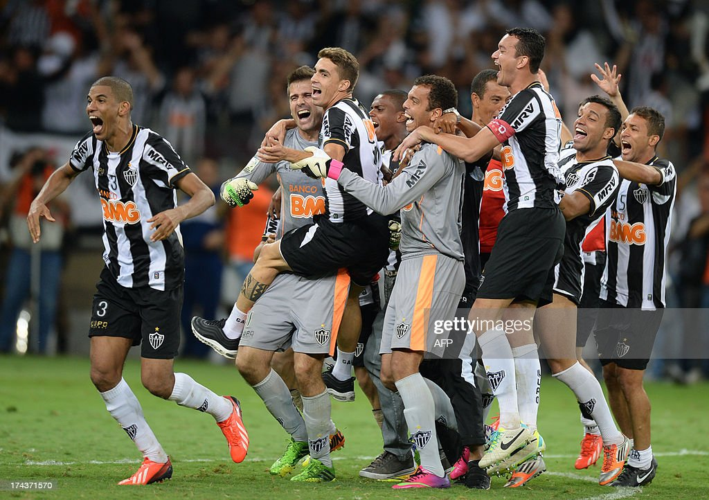 Brazilian Atletico Mineiro's players celebrate after winning their Libertadores Cup second leg final football match against Paraguayan Olimpia in a penalty shoot-out at the Mineirao stadium in Belo Horizonte, Brazil on July 24, 2013.