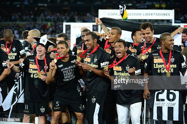 Brazilian Atletico Mineiro's pose with their medals atter winning the Libertadores Cup the second leg final football match against Paraguayan Olimpia...