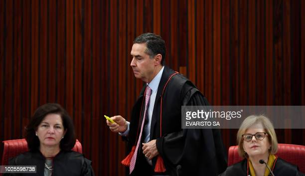 Brazilian Attorney General Raquel Dodge Superior Electoral Court's Judge Luis Roberto Barroso and the Court's President Judge Rosa Weber attend the...