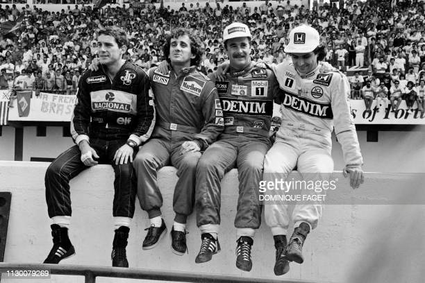 Brazilian Ayrton Senna, French Alain Prost, British Nigel Mansell, and Brazilian Nelson Piquet pose for photographers on Septpember 21, 1986 at the...