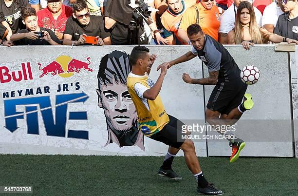Brazilian Barcelona player Neymar takes part in a fiveaside football match as part of a Neymar Junior Institute project in Praia Grande Sao Paulo...