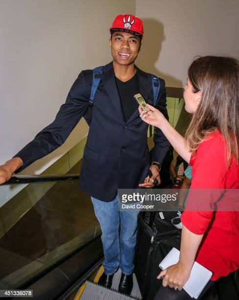 Brazilian Basketball player Bruno Caboclo drafted 20th over all by the Raptors arrives on Porter Airlines from Newark NJ at Billy Bishop Airport in...