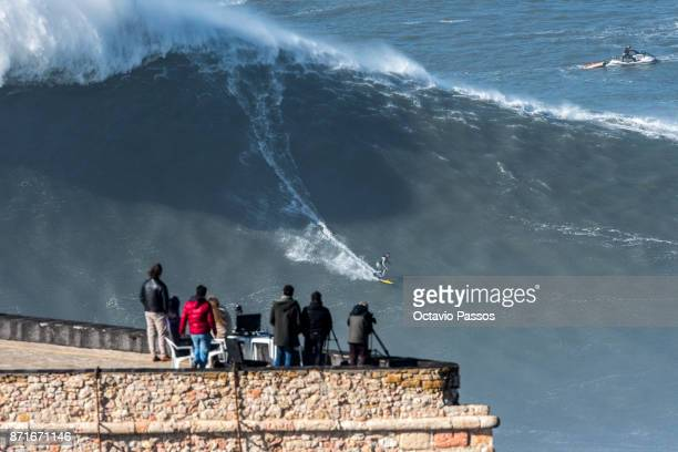 Brazilian big wave surfer Everaldo Pato Teixeira drops a wave during a surf session at Praia do Norte on November 8 2017 in Nazare Portugal