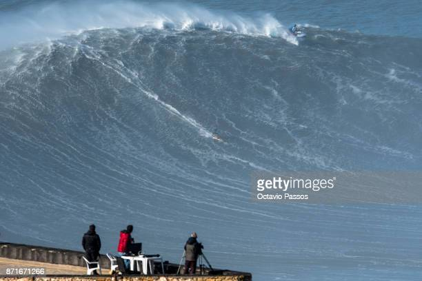Brazilian big wave surfer Marcos Monteiro drops a wave during a surf session at Praia do Norte on November 8 2017 in Nazare Portugal