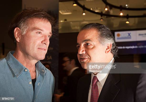 Brazilian billionaire Eike Batista left talks with Edemir Pinto chief executive officer of BMFBovespa SA at the OSX Brasil SA initial public offering...