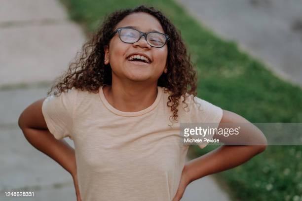 Brazilian black girl smiling and showing strong attitude