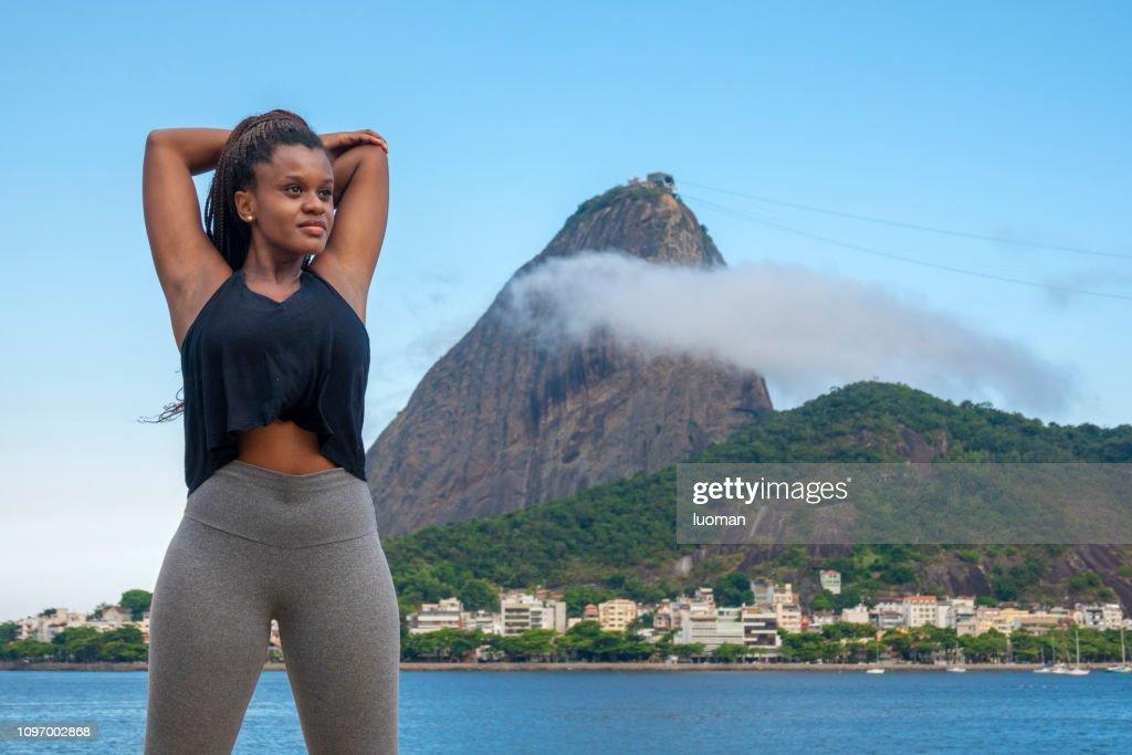 Brazilian black young woman making gymnastics : Stock Photo