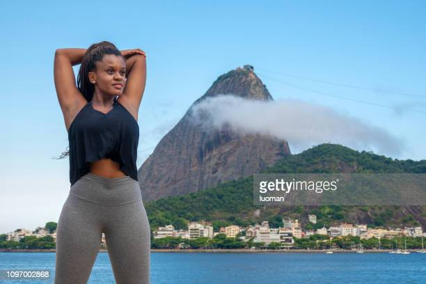 Brazilian black young woman making gymnastics