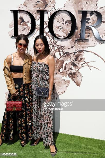 Brazilian blogger Camila Coelho and Aimee Song pose during the photocall before Christian Dior 2017 fall/winter Haute Couture collection show in...