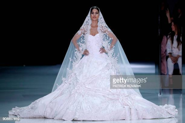 Brazilian blogger Camila Coelho presents a creation for Ralph Russo during the 2018 spring/summer Haute Couture collection fashion show on January 22...