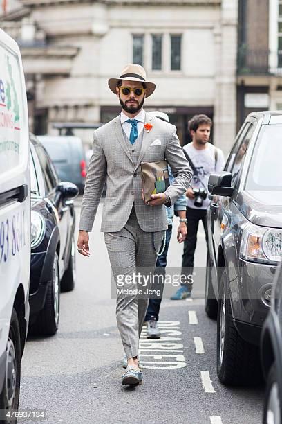 Brazilian blogger Kadu Dantas wears Ricardo Almeida during The London  Collections Men SS16 at on June 861cf893776