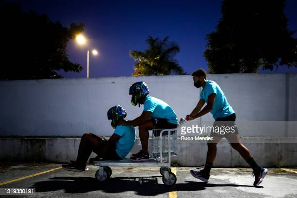 Brazilian bobsledders Gustavo Ferreira, Edson Martins and Rafael Souza play with the cart in the supermarket on May 20, 2021 in Sao Caetano do Sul,...