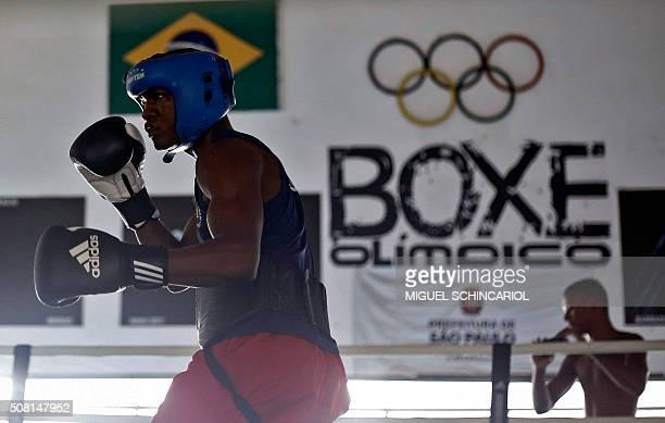 Brazilian boxer Roberto Custodio trains for the Rio 2016 Olympic Games in Sao Paulo Brazil on January 27 2016 Custodio was born in the Mare favela in...