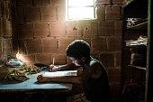 Brazilian boy studying at home