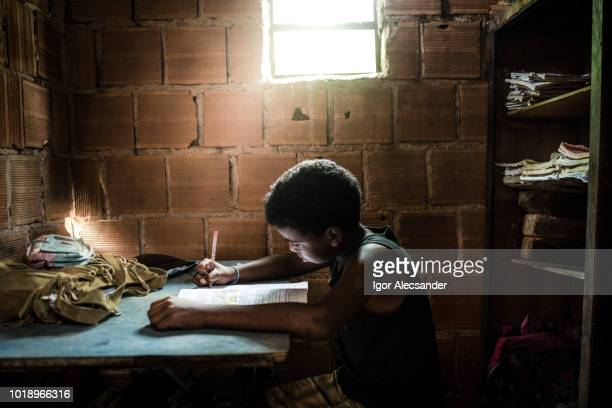 brazilian boy studying at home - poverty stock pictures, royalty-free photos & images