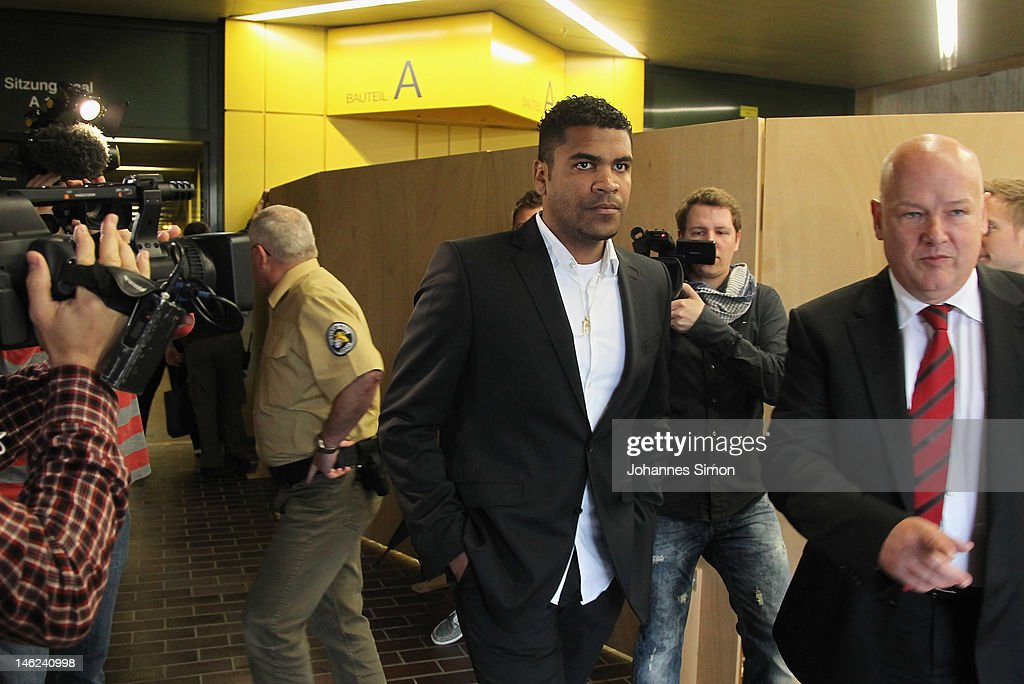 Brazilian Breno Vinícius Rodrigues Borges (C; beside of his lawyer Werner Leitner, R), so called Breno, former player of German football club FC Bayern Muenchen arrives for his trial at Munich district court on June 13, 2012 in Munich, Germany. German prosecutors have charged the Bayern Munich defender Breno with aggravated arson after his rented villa was burnt down on September 20, 2011.