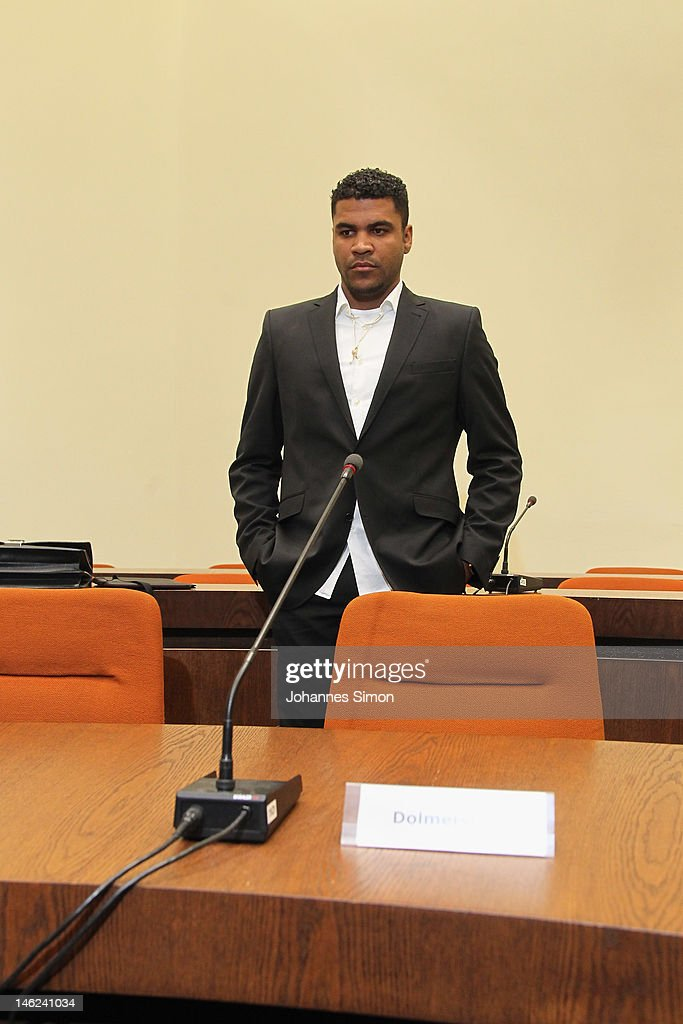 Brazilian Breno Vinícius Rodrigues Borges (R), so called Breno, former player of German football club FC Bayern Muenchen looks on ahead of his trial at Munich district court on June 13, 2012 in Munich, Germany. German prosecutors have charged the Bayern Munich defender Breno with aggravated arson after his rented villa was burnt down on September 20, 2011.