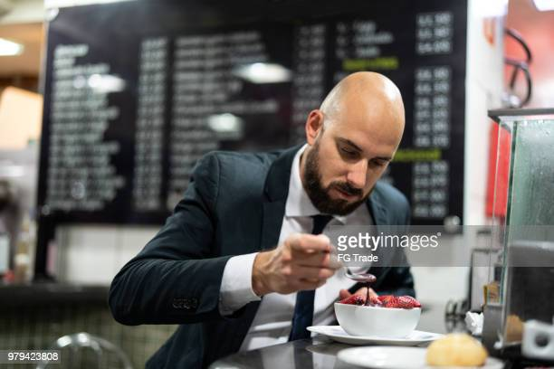 Brazilian Business man Eating Acai