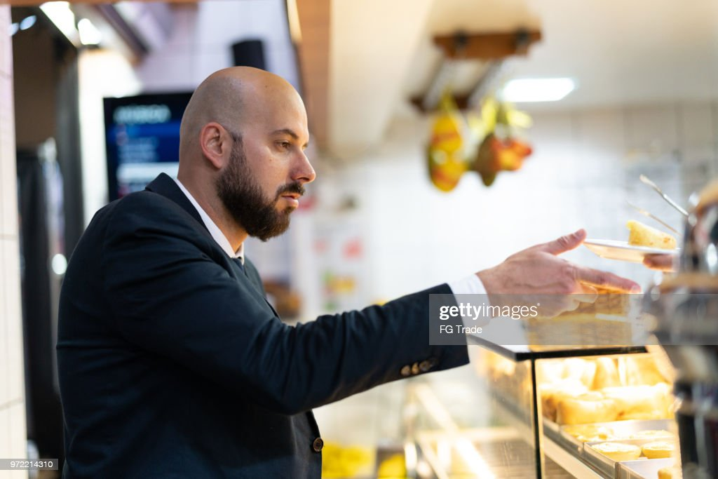 Brazilian Business man Getting Some Food : Stock Photo