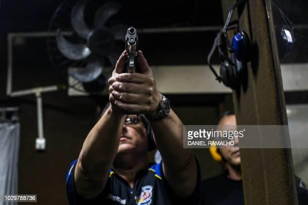Brazilian businessman Armando Piccinini prepares to shoot at the 'Calibre 12' shooting club in Sao Goncalo Rio de Janeiro Brazil on September 03 2018...
