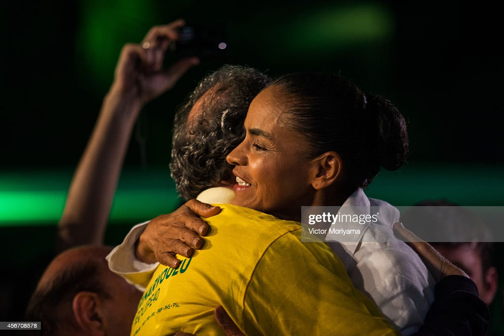 Brazilian candidate for President Marina Silva gives a hug during a press conference at the Brazilian Socialist Party on October 5, 2014 in Sao Paulo, Brazil. Marina Silva had 21% of the votes and will not move to the second round against the current President of the Republic, Dilma Rousseff and Aecio Neves.
