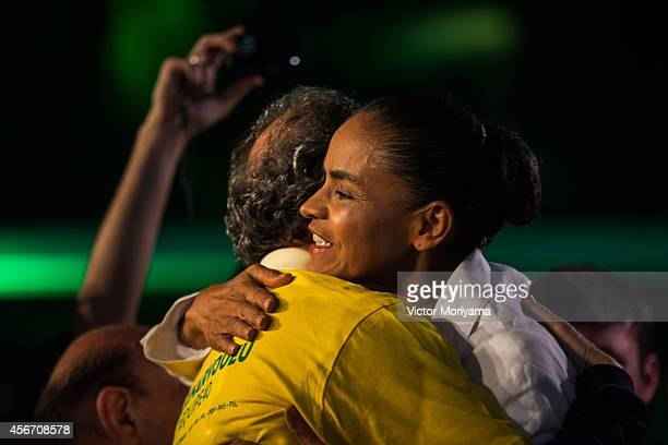 Brazilian candidate for President Marina Silva gives a hug during a press conference at the Brazilian Socialist Party on October 5, 2014 in Sao...