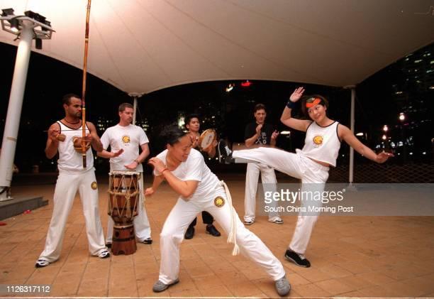 Brazilian capoeira master and teacher Preto , Fraser MacDonald , Karen Hu , Spark Ng , Christopher Eyers and Yero Ng in a capoeira class at Victoria...