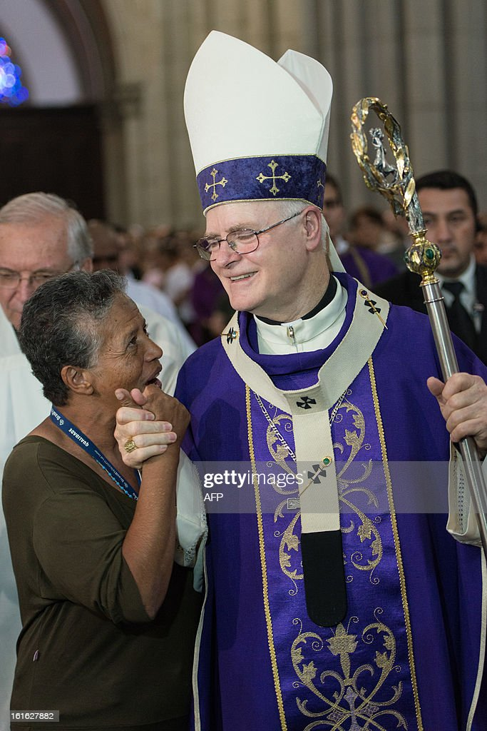 Brazilian Cardinal Odilo Pedro Scherer, Archbishop of Se Cathedral and considered in the running to be the future pope, greets a worshiper while celebrating Ash Wednesday mass at Se Cathedral in Sao Paulo, Brazil, on Februrary 13, 2013. Benedict XVI, the German-born leader of the world's 1.1 billion Catholics, made the shock announcement that he would resign on February 28 due to old age. Scherer, ordained cardinal by Benedict XVI in 2007 and who heads Brazil's largest archdiocese with five million Catholics, said in a press conference that nationality and age should not be key factors in choosing who will succeed Benedict XVI. AFP PHOTO / Yasuyoshi CHIBA
