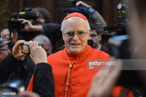 Brazilian cardinal Odilo Pedro Scherer speaks with faithfuls after a mass at the Saint Andrew's at the Quirinal church on March 10, 2013. Roman...