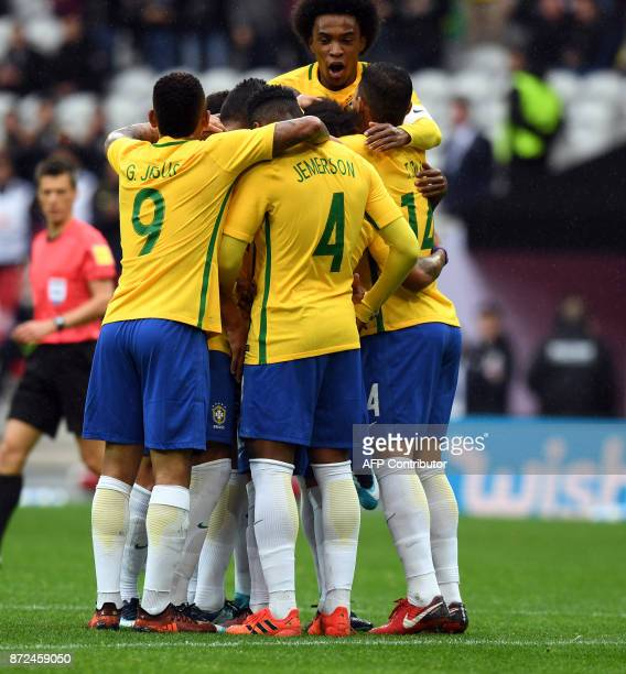 Brazilian celebrates after scoring a goal during the football match between Brasil and Japan at the Pierre-Mauroy Stadium in Villeneuve d'Ascq, near...