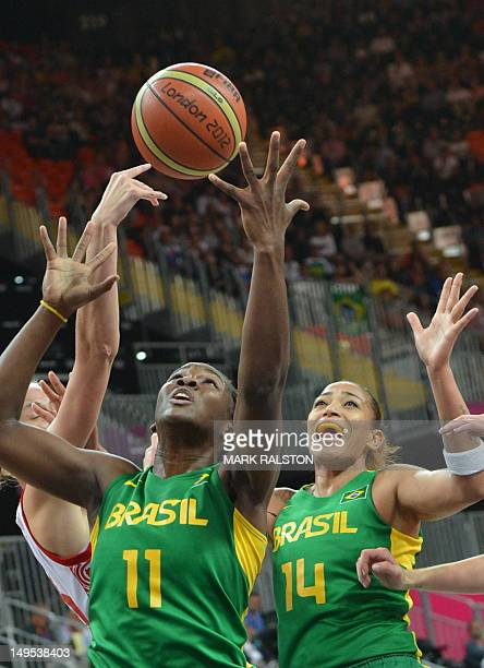 Brazilian centre Clarissa Santos and Brazilian centre Erika Souza try to catch the ball during the Women's preliminary round group B basketball match...