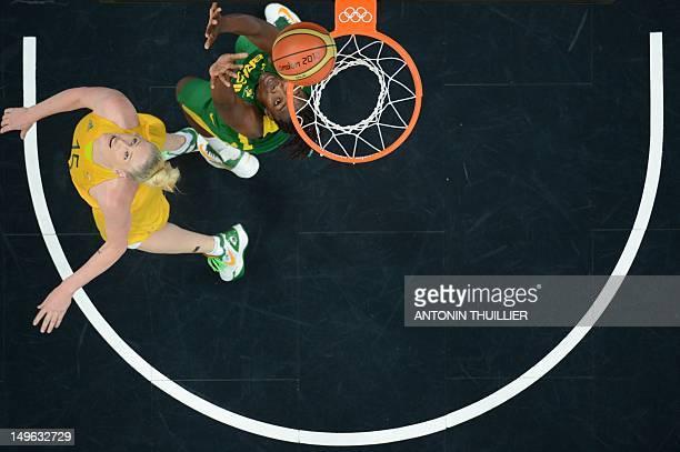 CAMERA Brazilian centre Clarissa Santos vies with Australian centre Lauren Jackson during the Women's preliminary round group B basketball match of...
