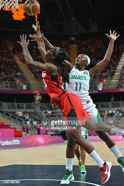 Brazilian centre Clarissa Santos vies with Canadian forward Tamara Tatham during the women's preliminary round group B basketball match Brazil vs...