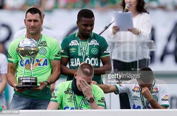 Brazilian Chapecoense Alan Ruschel and Jackson Follmann a survivor of the LaMia airplane crash in Colombia receives the Copa Sudamericana trophy in...