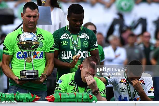 TOPSHOT Brazilian Chapecoense footballers Alan Ruschel and Jackson Follmann survivors of the LaMia airplane crash in Colombia receive the Copa...