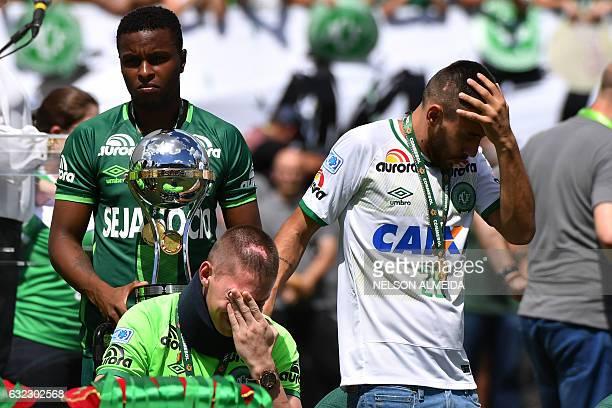 Brazilian Chapecoense footballers Alan Ruschel and Jackson Follmann survivors of the LaMia airplane crash in Colombia receive the Copa Sudamericana...