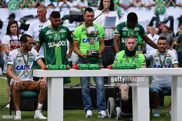 Brazilian Chapecoense footballers Alan Ruschel Helio Neto and Jackson Follmann survivors of the LaMia airplane crash in Colombia receive the Copa...