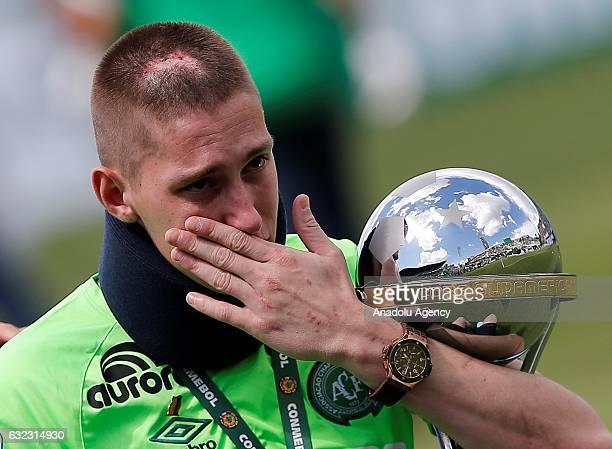 Brazilian Chapecoense goalkeeper Jackson Follmann a survivor of the LaMia airplane crash in Colombia receives the Copa Sudamericana trophy in Arena...